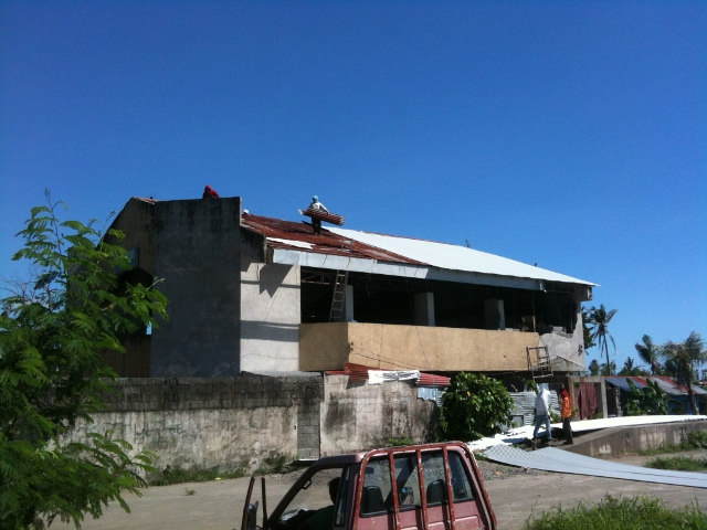 Installing New White Roofing On New Life Palo